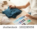 female fashion designer holding ... | Shutterstock . vector #1032285058