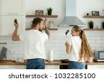 funny couple having fun... | Shutterstock . vector #1032285100