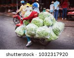 Small photo of A Person on the scooter carrying a bilk of green peas in the street of Can Tho, Vietnam
