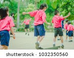 happy kindergarten students are ... | Shutterstock . vector #1032350560