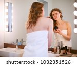 young woman looking in the... | Shutterstock . vector #1032351526