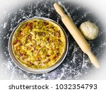 pizza on a plate and rolling pin | Shutterstock . vector #1032354793