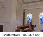 church pulpit inside a church. | Shutterstock . vector #1032376120