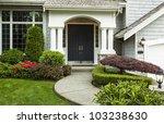 front door to home surrounded... | Shutterstock . vector #103238630