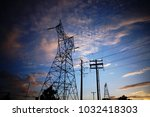 looking up at high voltage... | Shutterstock . vector #1032418303