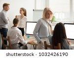 serious senior woman talking to ... | Shutterstock . vector #1032426190