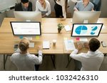 male employees using computers... | Shutterstock . vector #1032426310