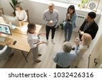 team leaders meet multiracial... | Shutterstock . vector #1032426316