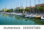 yachts in the port waiting.... | Shutterstock . vector #1032437683