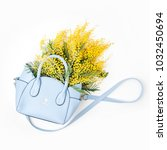 a bouquet of yellow flowers in...   Shutterstock . vector #1032450694