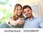 couple in sofa watching tv | Shutterstock . vector #103248449