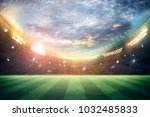 stadium in lights and flashes... | Shutterstock . vector #1032485833