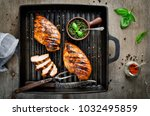 chicken fillet in the grill pan.... | Shutterstock . vector #1032495859