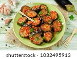 eggplant slices in a spicy red... | Shutterstock . vector #1032495913