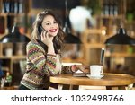 young businesswoman at cafe | Shutterstock . vector #1032498766