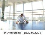 dancer in white suit making...   Shutterstock . vector #1032502276