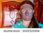 spa teen girl applying facial... | Shutterstock . vector #1032523306