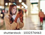 blonde woman taking photograph... | Shutterstock . vector #1032576463