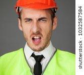 the builder in the helmet... | Shutterstock . vector #1032587584