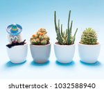 cactus on pastel color... | Shutterstock . vector #1032588940