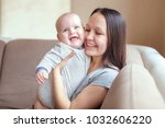 mother and a baby boy at home | Shutterstock . vector #1032606220