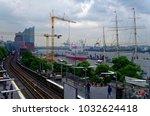 historic harbor in hamburg with ... | Shutterstock . vector #1032624418
