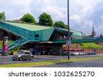 historic harbor in hamburg with ... | Shutterstock . vector #1032625270