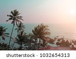 palm trees silhouettes against... | Shutterstock . vector #1032654313