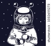 the girl astronaut holds a... | Shutterstock .eps vector #1032655273