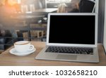 laptop and coffee cup on wood... | Shutterstock . vector #1032658210