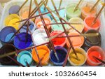 Many Colored Open Cans With...