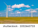 offshore and onshore windmill... | Shutterstock . vector #1032663733