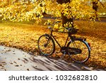 bicycle on the autumn street of ... | Shutterstock . vector #1032682810