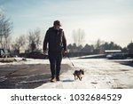 young dog instructor walking a... | Shutterstock . vector #1032684529