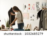 female tailor or seamstress... | Shutterstock . vector #1032685279