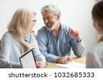 happy senior family talking... | Shutterstock . vector #1032685333