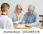 aged couple signing contract... | Shutterstock . vector #1032685378
