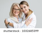 happy beautiful older mother... | Shutterstock . vector #1032685399