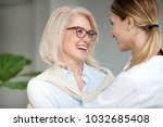 beautiful aged woman in glasses ... | Shutterstock . vector #1032685408