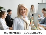 smiling female aged company... | Shutterstock . vector #1032686050