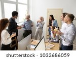 friendly diverse business team... | Shutterstock . vector #1032686059