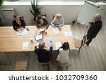 senior business mentor coaching ... | Shutterstock . vector #1032709360
