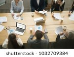business young and senior... | Shutterstock . vector #1032709384