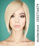 fashion studio portrait of...   Shutterstock . vector #1032716674