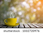 coffee cup and bokeh background | Shutterstock . vector #1032720976