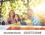 beautiful young smiling family... | Shutterstock . vector #1032721048
