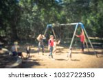 Small photo of Blurred abstract outdoor playground activities at public park in Texas, America. Children play on swing, kids and parents doing activity together background