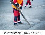 road worker cutting asphalt... | Shutterstock . vector #1032751246