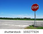 stop sign in a country road on... | Shutterstock . vector #103277324