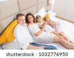 happy family laying on hotel... | Shutterstock . vector #1032776950